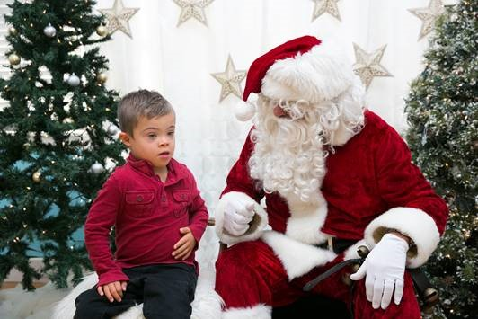 Child sitting with Sensitive Santa