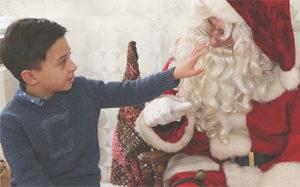 Young boy visiting with Sensitive Santa