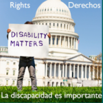 Person holding Disability Matters sign