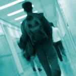 child walking down school hallway